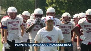 High school football players staying cool during practices