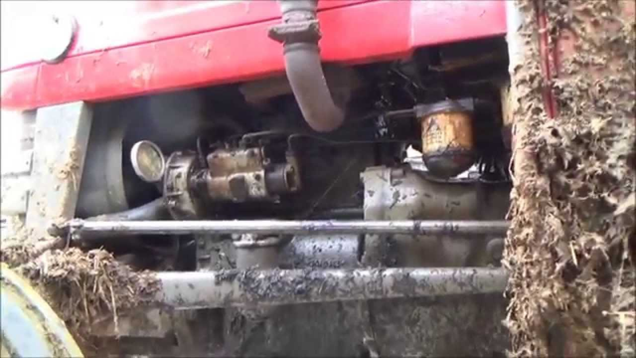 hight resolution of changing the oil filter on a massey ferguson 135 tractor