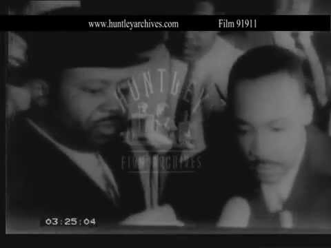 Martin Luther King assaulted in Selma.  Archive film 91911
