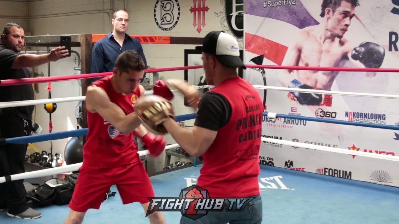 CARLOS CUADRAS HITS MITTS WITH OLD SCHOOL BOXING GLOVES, SCHOOLS REPORTERS  ON BENEFITS