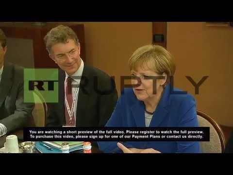 Italy: See Putin and Merkel talk Ukraine over breakfast at ASEM