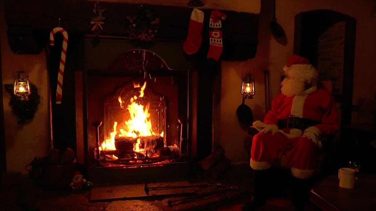 Santa Claus Relaxing at the Crackling Christmas Fireplace ...