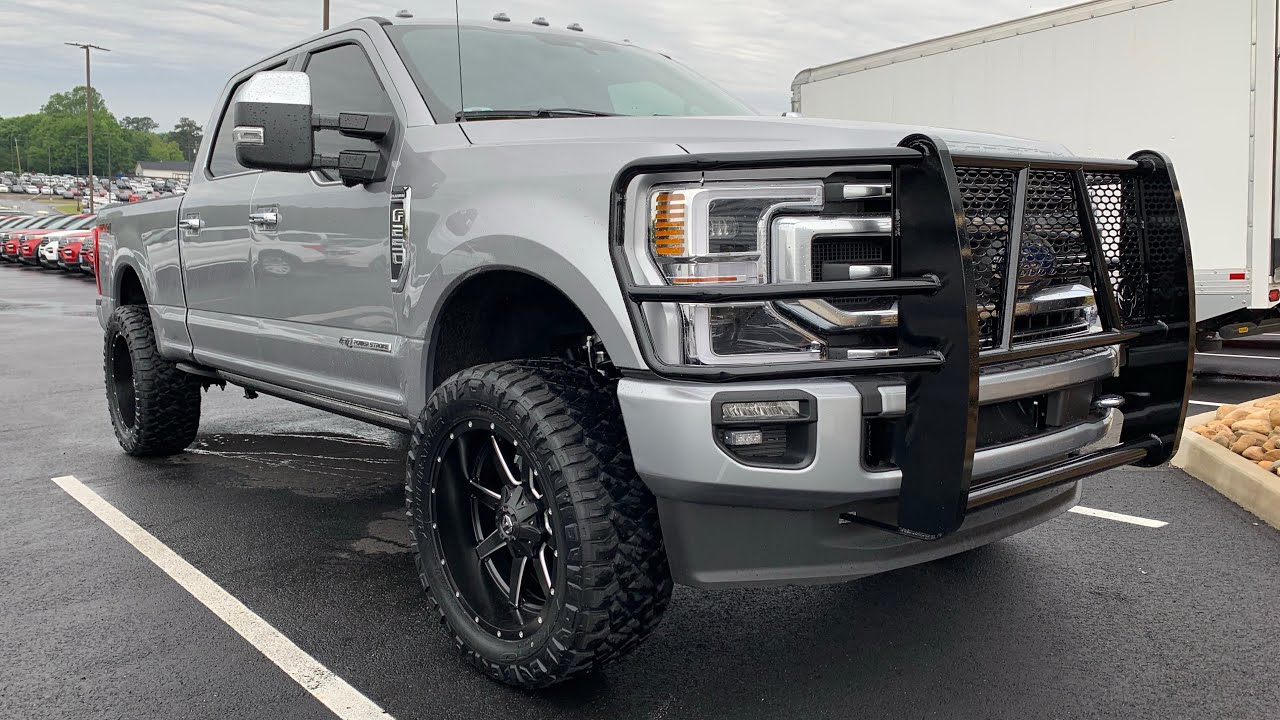 2020 ford f250 platinum leveled on 35s iconic silver
