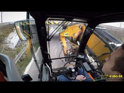 Liebherr A918 Wheeled Excavator Driving Under Low Bridge - Cab View