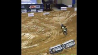 Pee wee kid racing on supercross track sends it and crashes