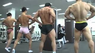 Young Bodybuilders Posing at University Gym