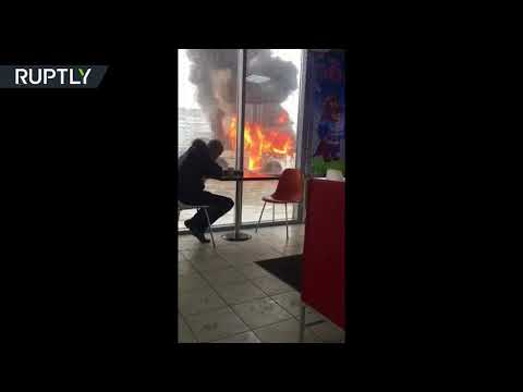 Food first, then panic: Guy chows down while bus is engulfed in flames