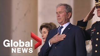Emotional George W. Bush watches as his father's casket arrives at U.S. Capitol