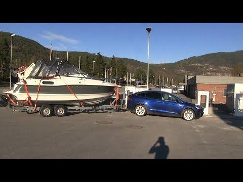 Model X towing a big boat
