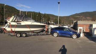 Model X towing a big boat
