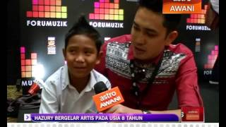 Hazury bergelar artis pada usia 8 tahun