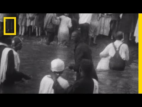 Rare Footage: Hundreds Gather at a 1920s African-American Baptism   National Geographic