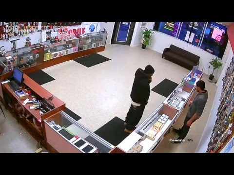 Armed Robbery Attempt At Cellphone Shop ! But Owner Fights Back HARD