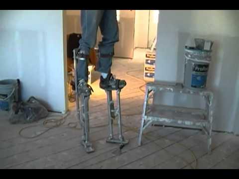 Drywall taper trick on stilts