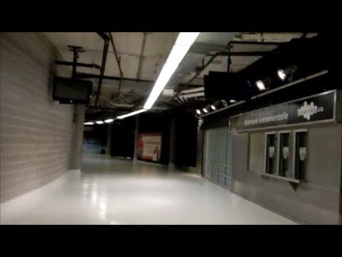 WALKING INDOORS FROM THE BELL CENTER TO BONAVENTURE METRO STATION IN MONTREAL