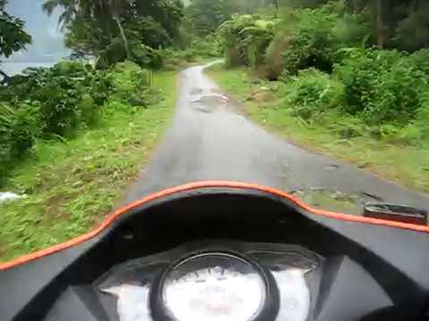 Driving around Lake Maninjau on a moped.