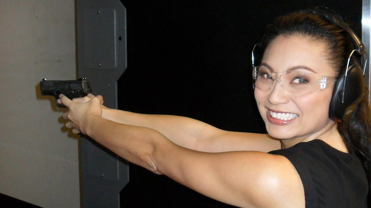 woman pointing gun downrange