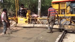 CONCRETE ROAD CONSTRUCTION WITH FIX FORM PAVER