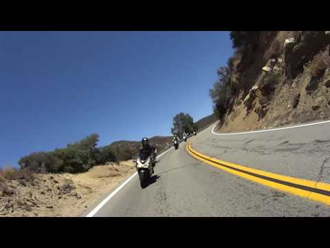 Cyclist joins, then overtakes motorcycles