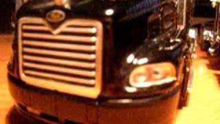 custom 1/32   trucks.  2 Peterbilt Tractors and   Mack