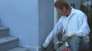 Repair stucco or plaster cracks with caulking