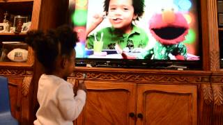 Zaria loves the Elmo Toothbrushing Song.