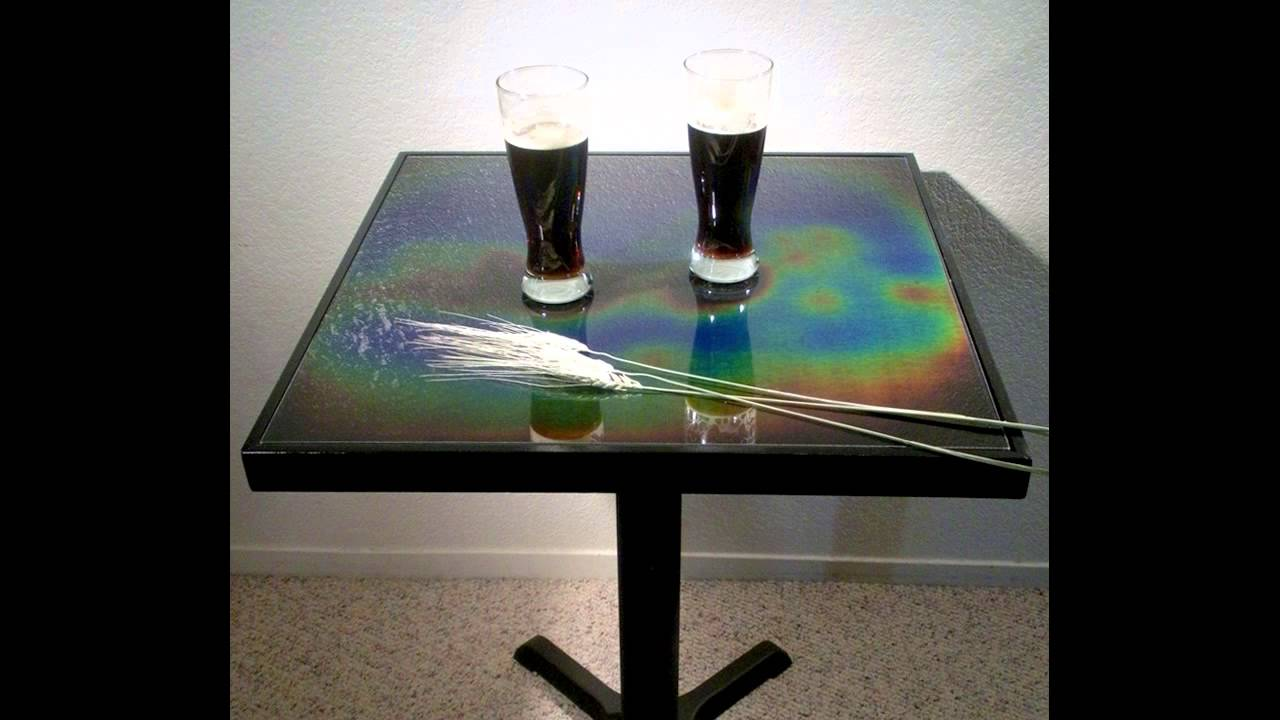 Moving Color Tiles aurora table: thermally activated color changing glass panels
