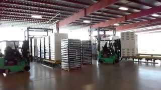 Rotary Arm Wrapper with Film Slitter for the produce industry