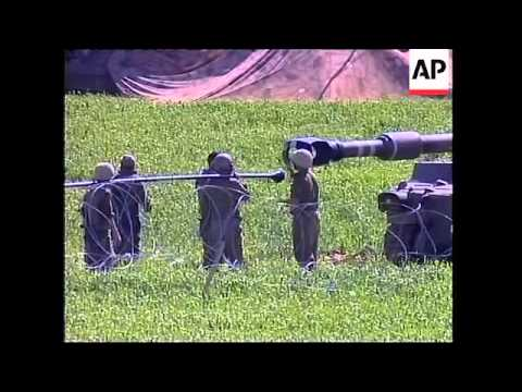 Israeli artillery shell suspected Palestinian militant positions