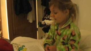 My daughter reading Dr Seuss