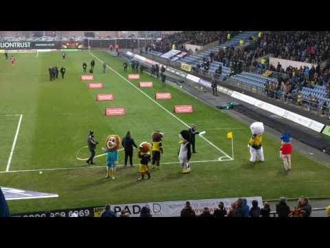 Oxford united v Oxford city stars,ice rink penguin and Oxford mail mascots.