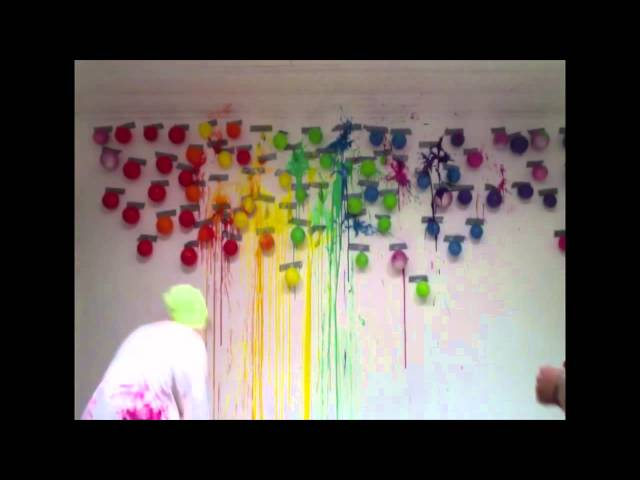 They Tape Balloons Full Of Paint On The Wall When They Pop Them