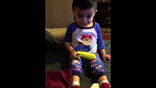 22 month old toddler reciting first words using flash cards