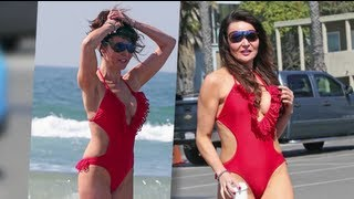 Lizzie Cundy looks smokin' in a red hot bikini