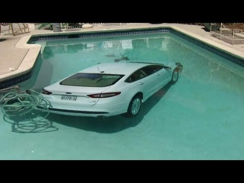 Man Drives Car Into Swimming Pool After Getting Flip Flop Tangled On Accelerator Pedal!!!