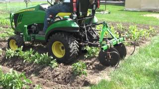 John Deere 1025R Hilling Potatoes & Corn with Disc Hillers / Listers