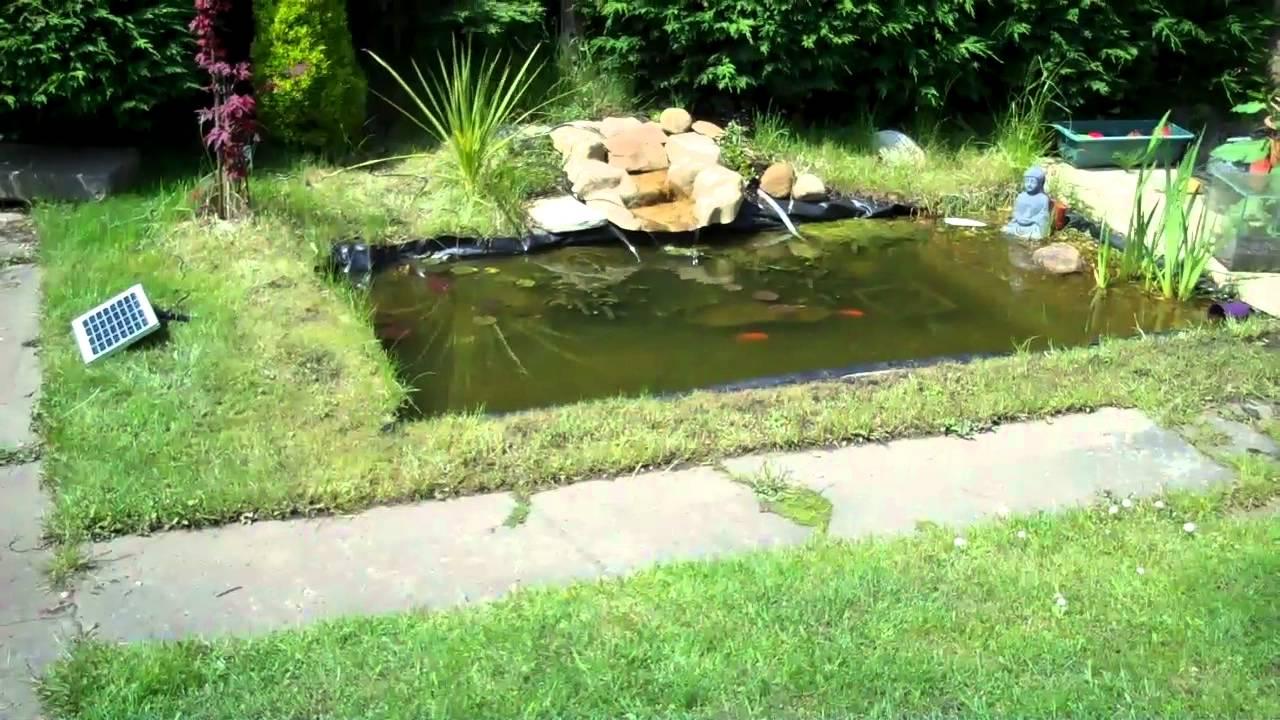 Pond liner solar pump in action youtube for Coy pond pump
