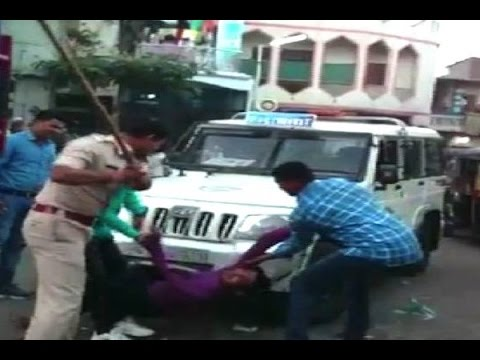 Surat police beat up two alleged eve teasers publicly