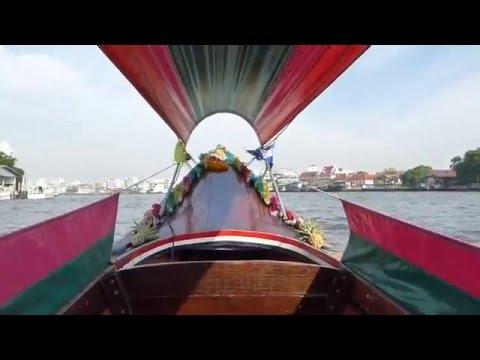 Exploring Bangkok's Chao Phraya River by long-tail boat.