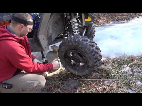 Stranded in the woods with POLARIS RZR - How to fix a flat with starter fluid and a lighter!