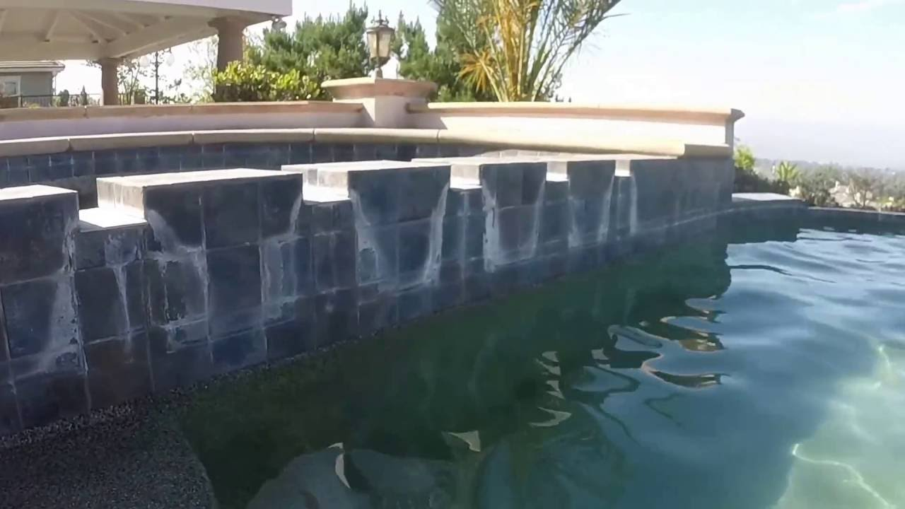 Have a Blast - Pool Tile Cleaning on Infinity Edge Pool - YouTube