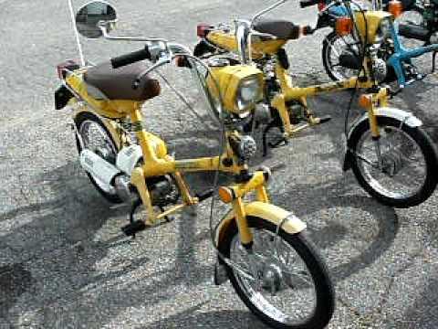 4 different Honda Express mopeds.
