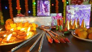 Bokeh shot of beautiful burning Diyas, gift boxes, sweets and crackers - Hindu Festival Diwali in India