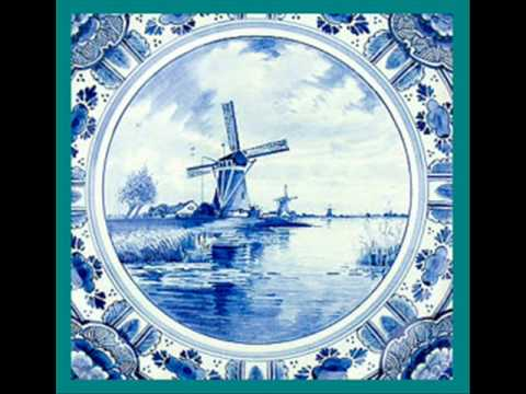 An Antique Delft holland Blue wall plate hand painted & What it is worth?