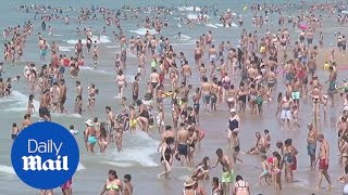 People invade beaches in Lisbon as heatwave hits Europe
