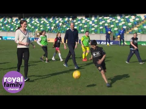 The Duke and Duchess of Cambridge join children on the pitch at Windsor Park, Belfast
