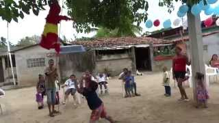 Boy Breaks Open The Candy Filled Doll In Traditional Mexican Piñata