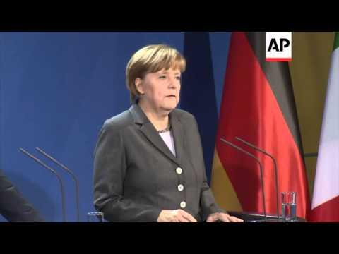 Merkel meets Italian Premier Matteo Renzi; justifies sanctions against Russia