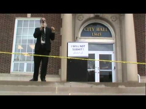 Rabbi Nachum Shrifren speaks at City Hall in Dearborn, MI