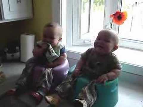 Twins Giggling in Bumbos